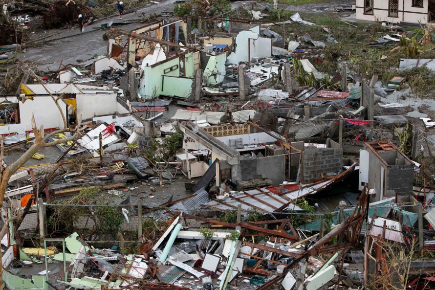 Damaged houses near the airport are seen after super Typhoon Haiyan battered Tacloban city