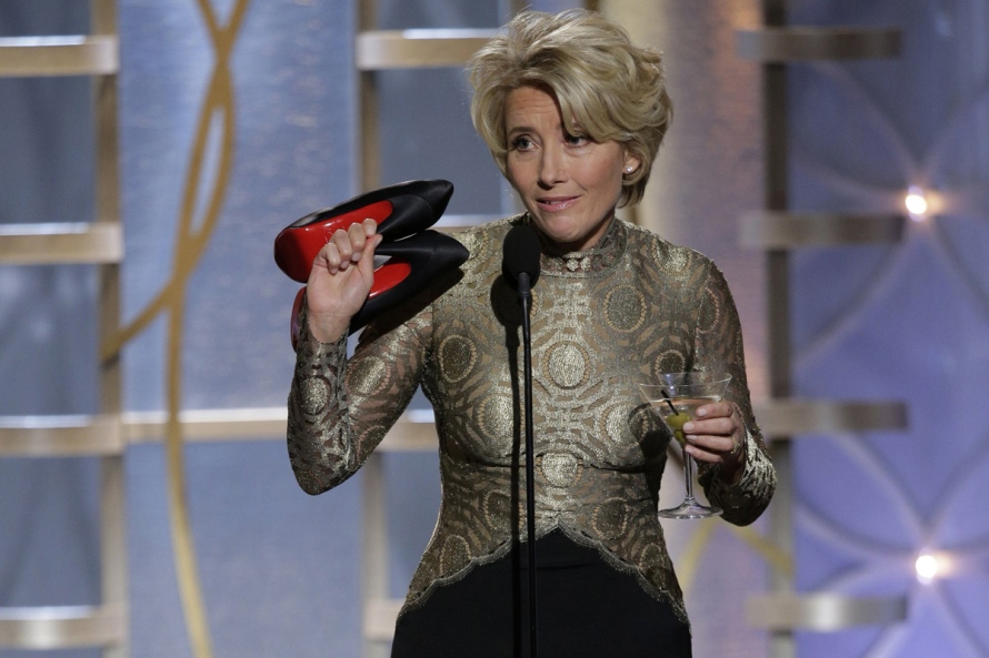 Emma Thompson takes off her shoes during the 71st annual Golden Globe Awards in Beverly Hills